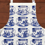 Load image into Gallery viewer, Craft the perfect Afternoon Tea with our exquisite hand printed 100% cotton Teacup apron! In gorgeous blues, this high quality apron will have you looking like a kitchen superstar while protecting you from any potential icing sugar disasters! This Thornback & Peel apron would make a wonderful gift for yourself or a loved one.