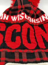 Load image into Gallery viewer, Red & black plaid pattern covers this very warm pom pom hat, with Wisconsin text across the body Email to a Friend