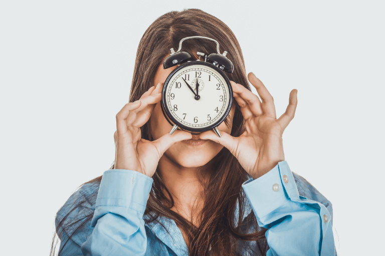 Woman holding clock - uncomplicated skincare