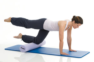 Woman exercising on TOGU Pilates Foam Roller Premium