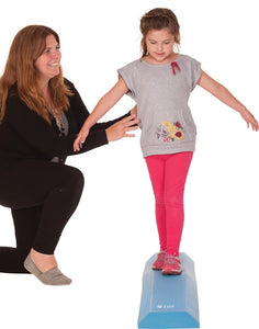 Young girl walking on airex balance beam