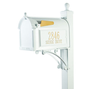 Whitehall white cast aluminum mailbox with custom address plaque on the side in gold letters and gold flag