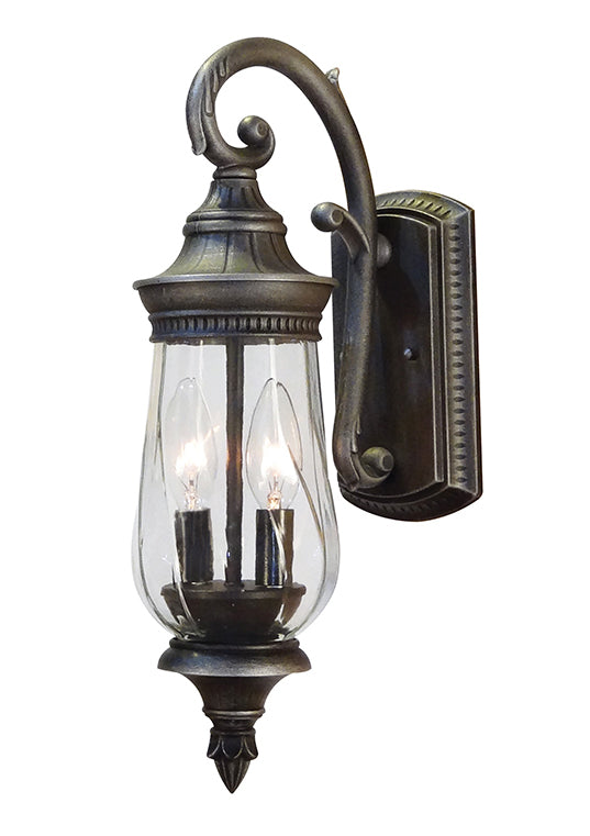 Caldwell top mount outdoor light with an ornate backplate and post and clear glass lantern type globe
