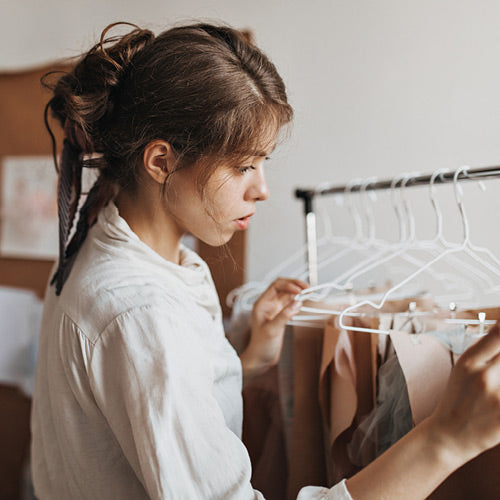 Clothes Mentor employee working with a clothing rack
