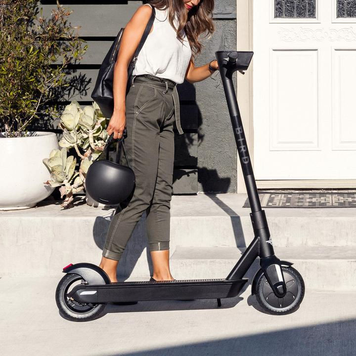 BIRD ONE Adult electric scooter with lady