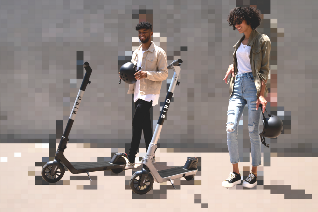 BIRD AIR Adult electric scooter. Male and female approaching scooters in urban area