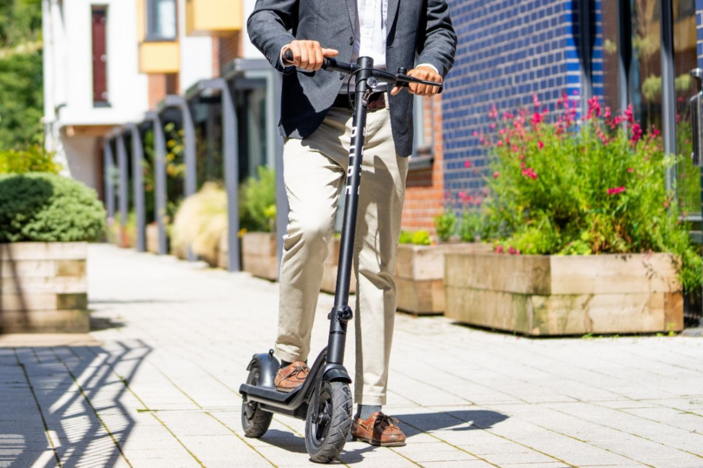 Pure Air adult electric scooter being used in urban area