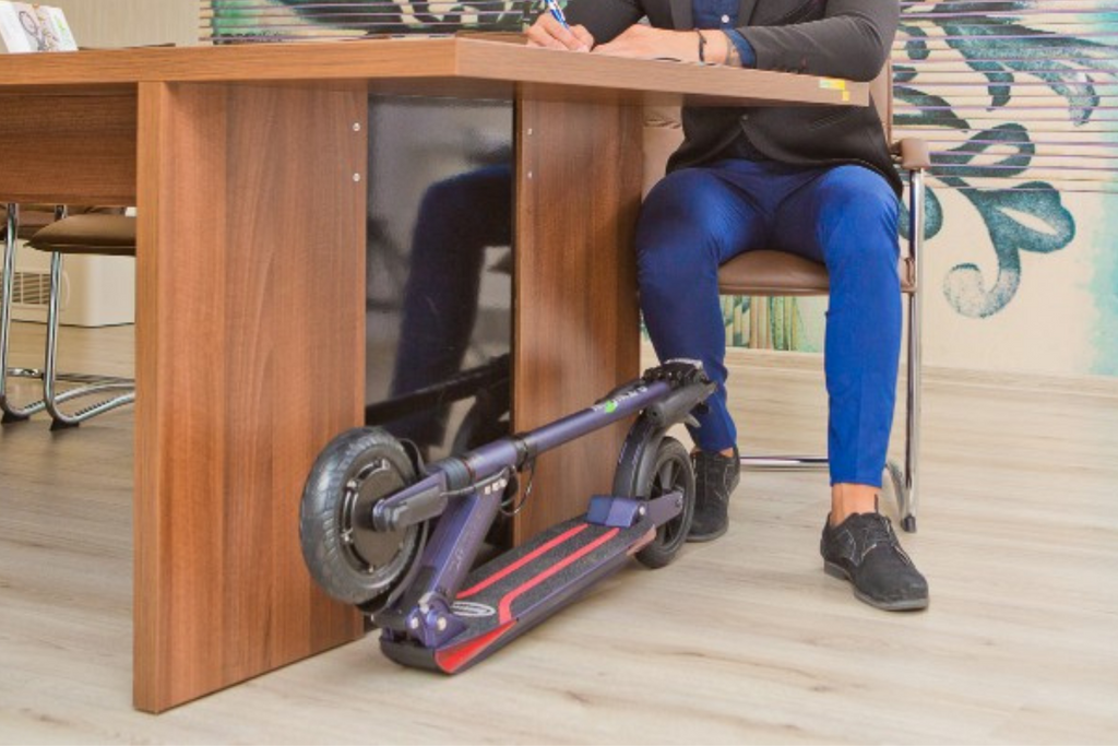 E-TWOW BOOSTER S+ Adult electric scooter folded under desk