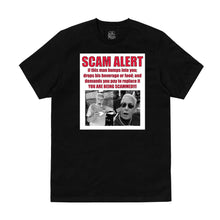 "Load image into Gallery viewer, ""Charlie Da Scammer"" T-Shirt in Black or White"