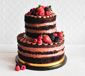 Chocolate naked cake with chocolate buttercream and mixed berries