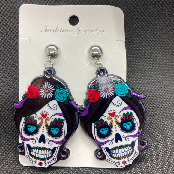 La Calavera catrina earrings. White skull with multi-colored accents