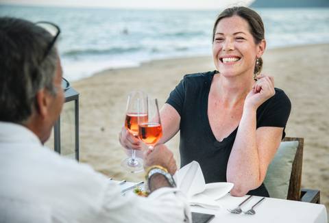 Romantic dinner on the beach with rosé
