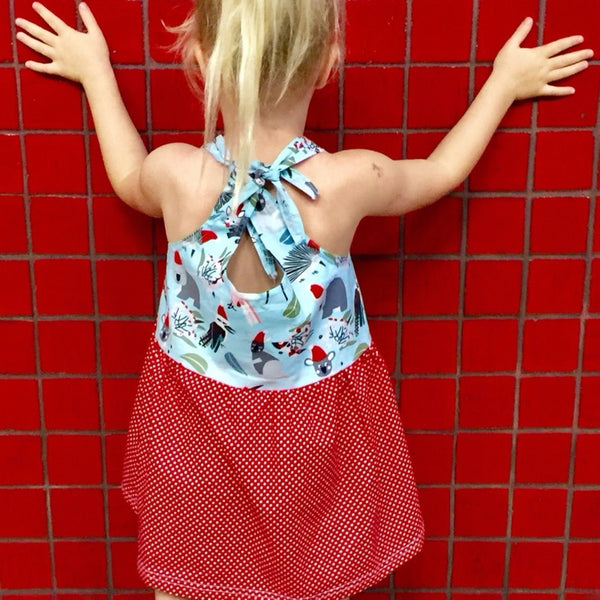cookie empire tie shoulder strap dress spot skirt and upper body Australiana Santa hat animals print back of the garment on a girl