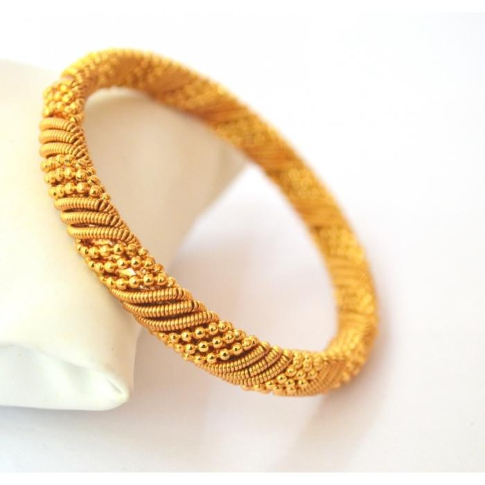 Simple twisted gold plated bangle