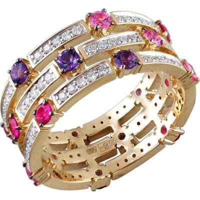 Esthete ring with a scattering of colored and precious stones in Yellow Gold