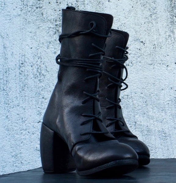 nutsa modebadze high heel boot