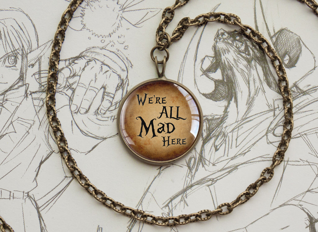 "Alice in Wonderland pendant ""We're all mad here "" quotation"
