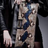 Model with Anya Sushko Hiss Camelot Python Oversized Clutch