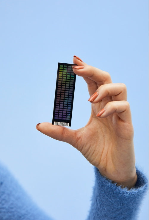 Photo: Hand holding genetic testing chip