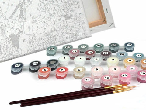 A paint-by-numbers kit with different colored paints and brushes