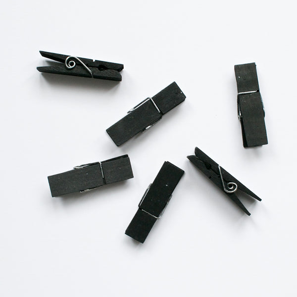 SET OF 12 BLACK WOODEN PEGS