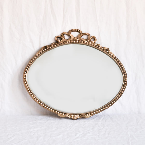 VINTAGE 'VIOLETTE' SMALL OVAL BRASS MIRROR