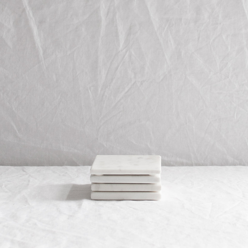 WHITE MARBLE COASTERS SET OF FOUR
