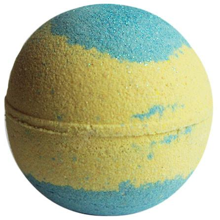 Photograph of the bath bomb from New York Bathhouse, which is colored in a yellowish sand color and an ocean blue with a sprinkle of glitter.