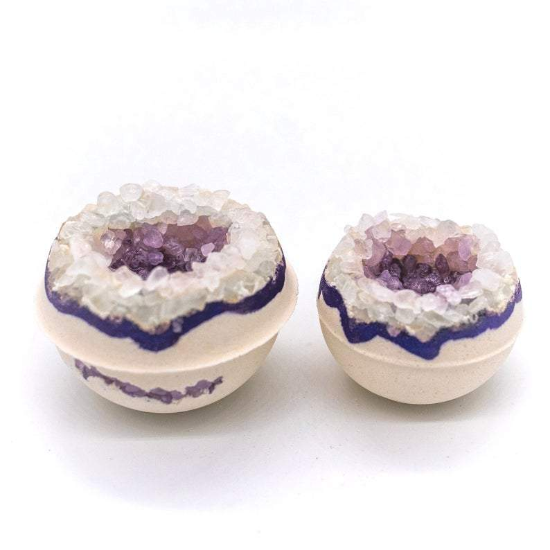 Photographs of different arrangements of the bath bombs in Amethyst Geode, the product resembles a geode type of stone.