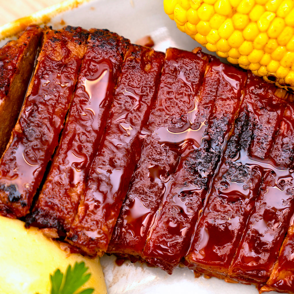 Close-up of Rudy's Vegan Diner's Rack of meatless vegan ribs. Allergens: gluten, mustard, celery  May contain: soy, nuts, sesame seeds, peanuts