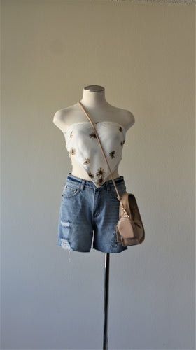 cut off denim shorts paired with floral handkerchief tube top