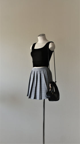 black plaid pleated mini skirt paired with square neck crop top in black
