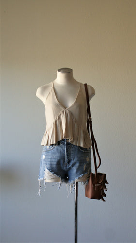 sand tiered tank top paired with distressed denim shorts