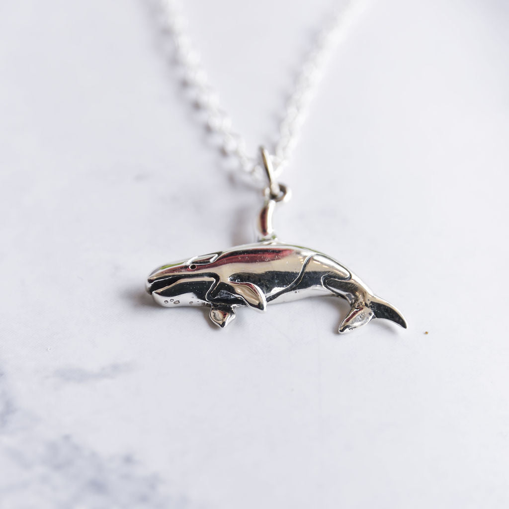 Sterling silver orca necklace.