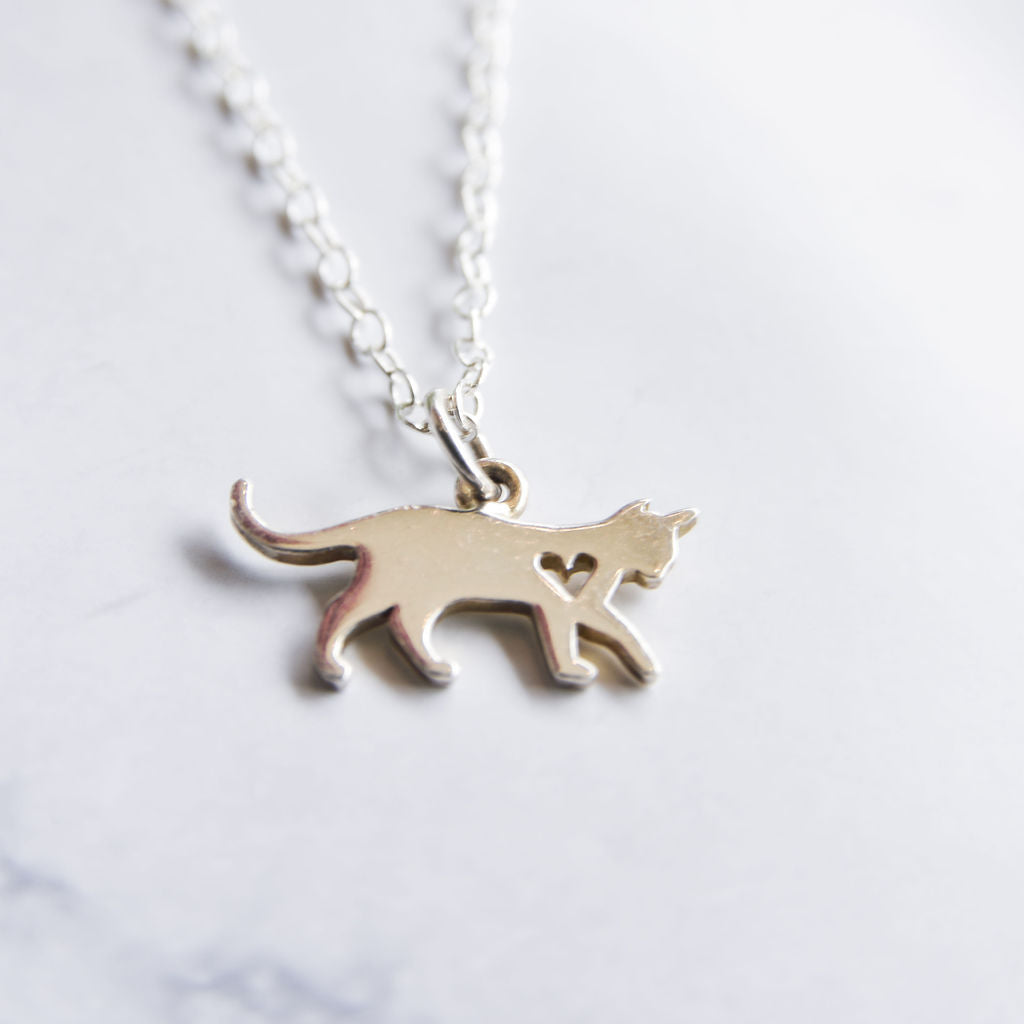 Sterling silver cat necklace with cut out heart.