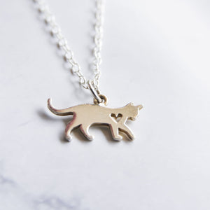 Close up of sterling silver cat necklace with cut out heart.