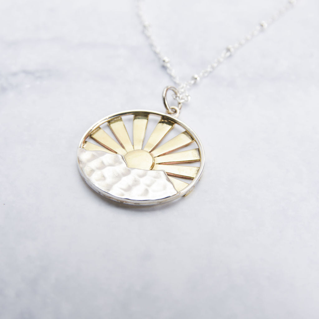Stunning sterling silver and bronze sunrise pendant.