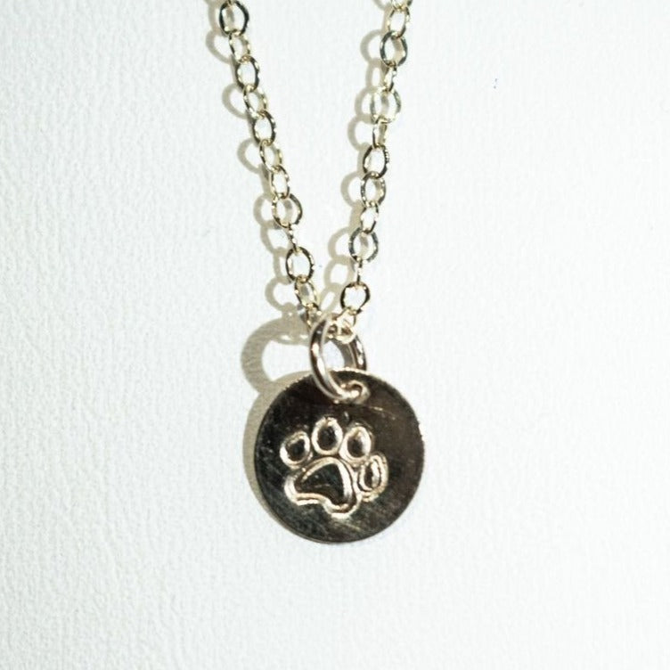 Dog paw print necklace, gold.