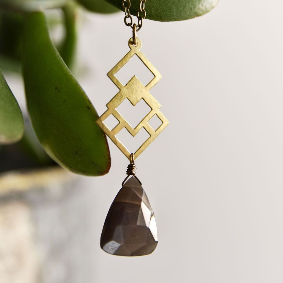Geometric brass necklace with coffee moonstone pendant.