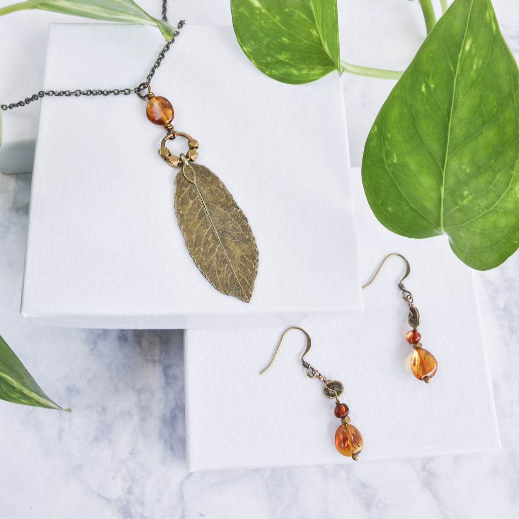 Brass leaf necklace with baltic amber