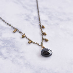 Small pear onyx and brass dangling necklace.