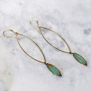 close up of marquise turquoise earrings