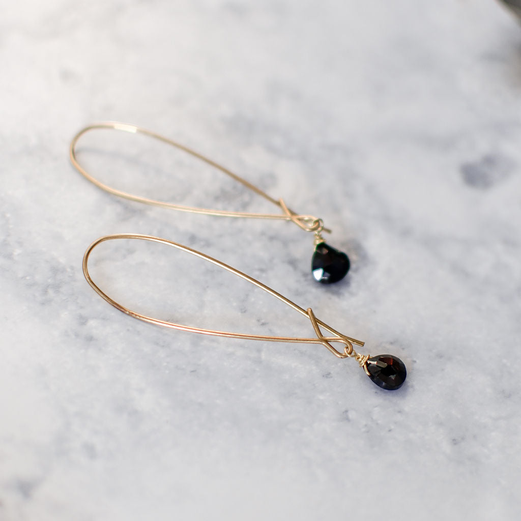 Black spinel drop earrings on brass