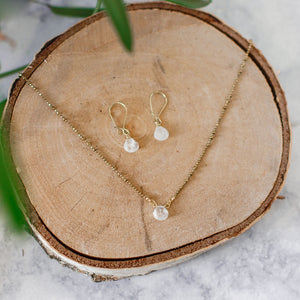White moonstone earrings and necklace on brass