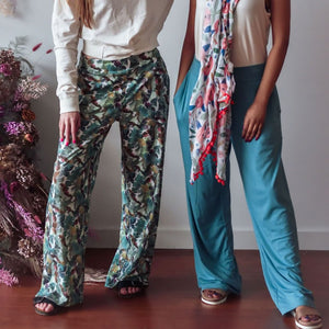 Palazzo pants on two models - featuring colors teal and tropical