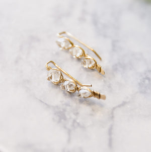 gold herkimer ear climbers close up