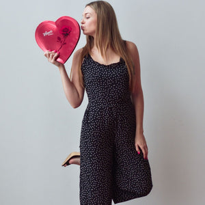 Black dot jumpsuit and model