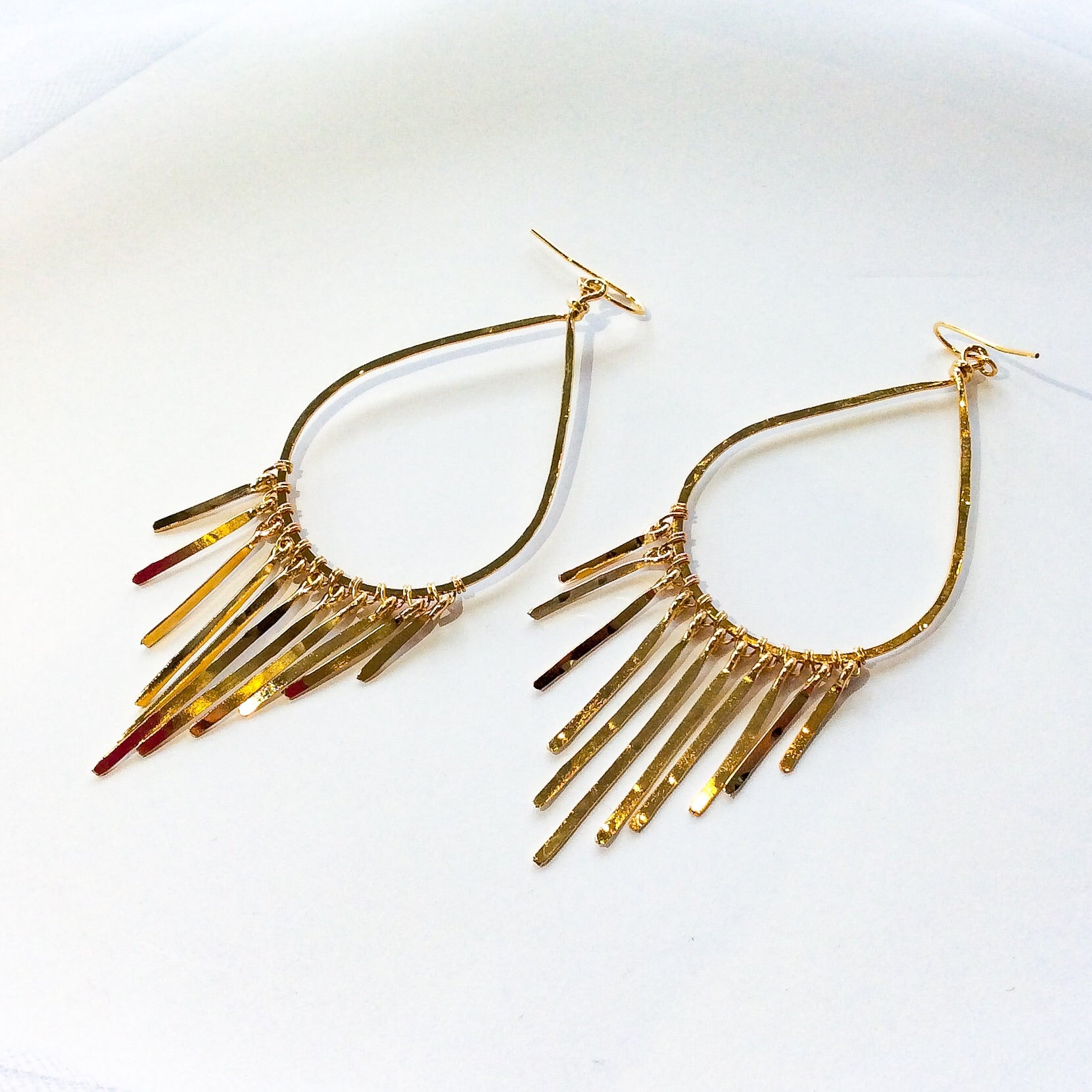 large gold plated hammered teardrop hoops with hammered, fringe bars dangling at the end