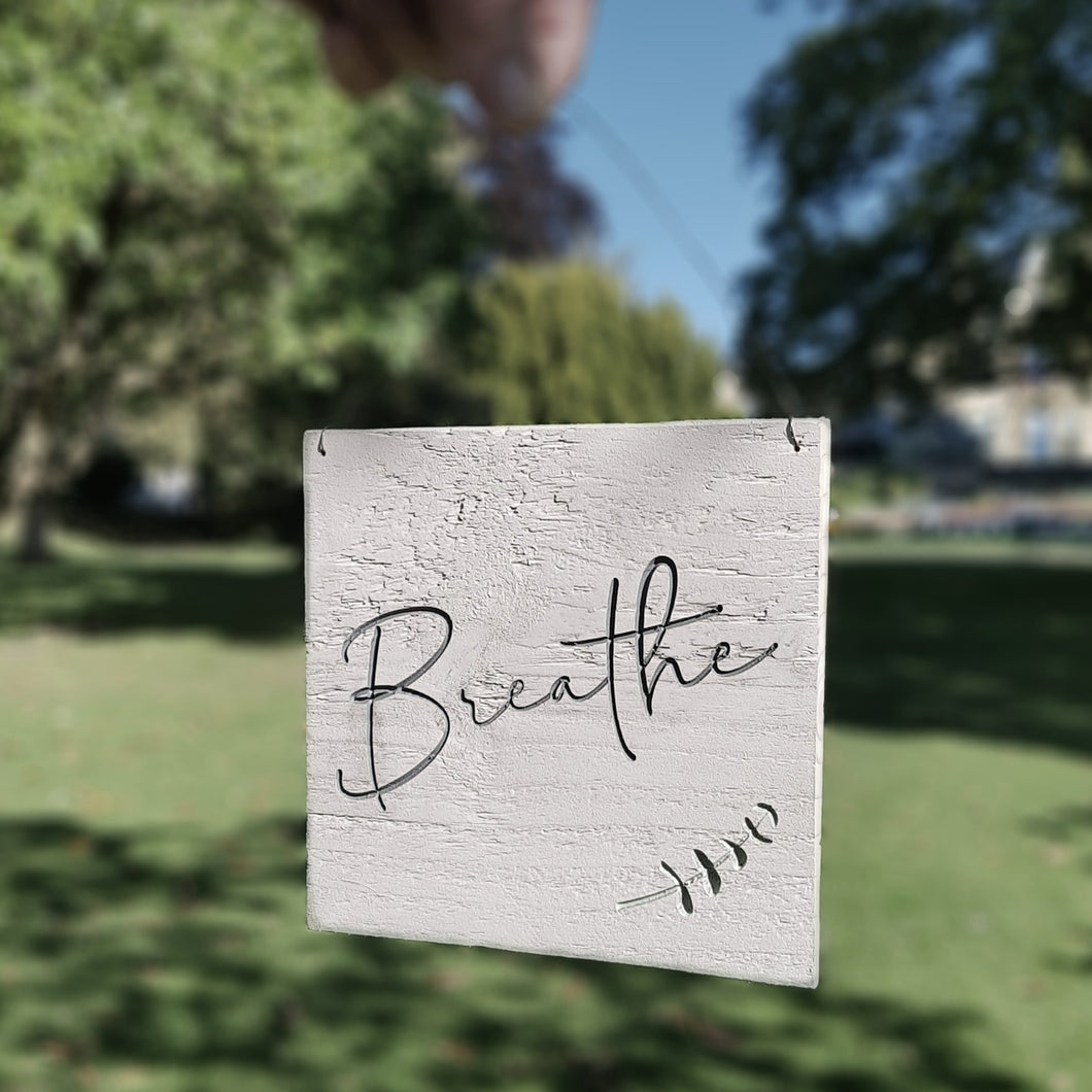 Engraved Breathe Sign