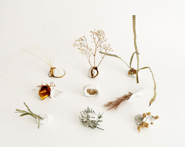 small sculptures made from clay and plant matter